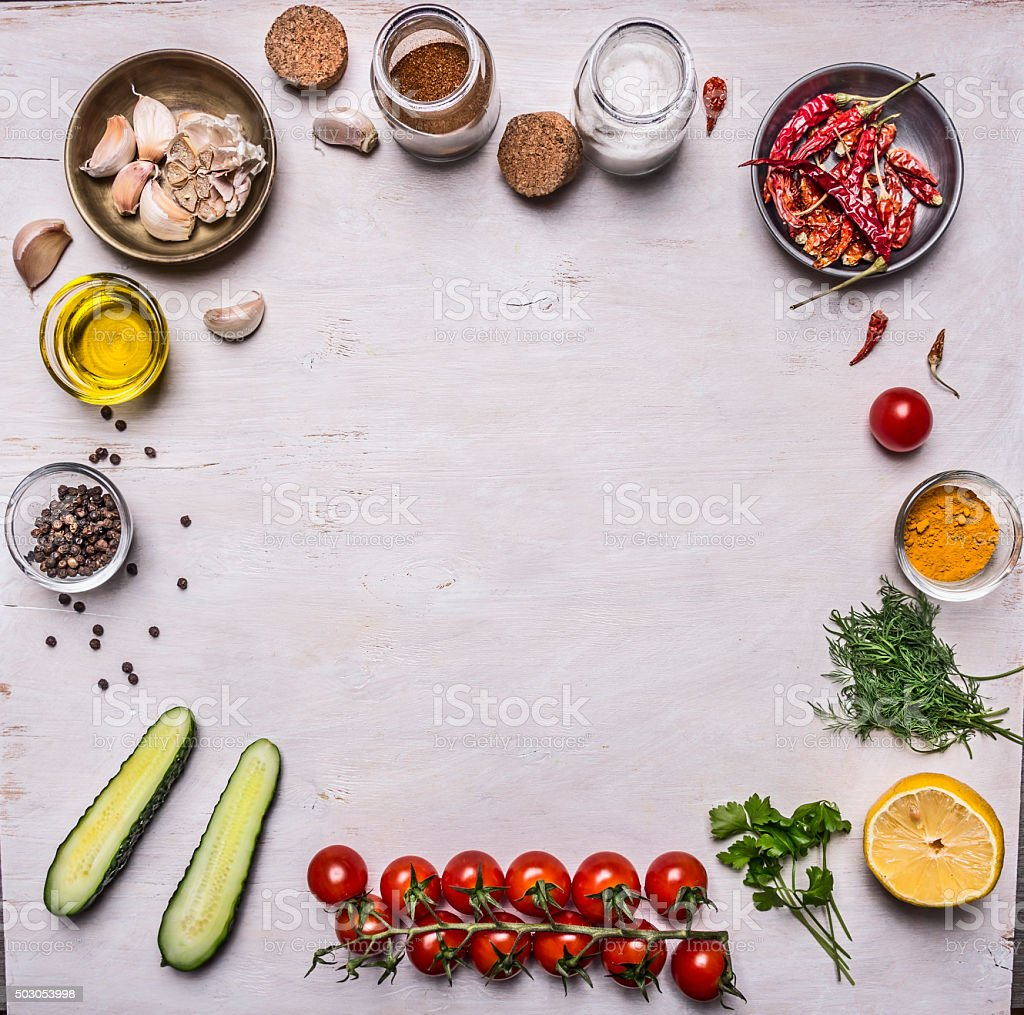 vegetables seasonings, frame laid white wooden background  top view stock photo