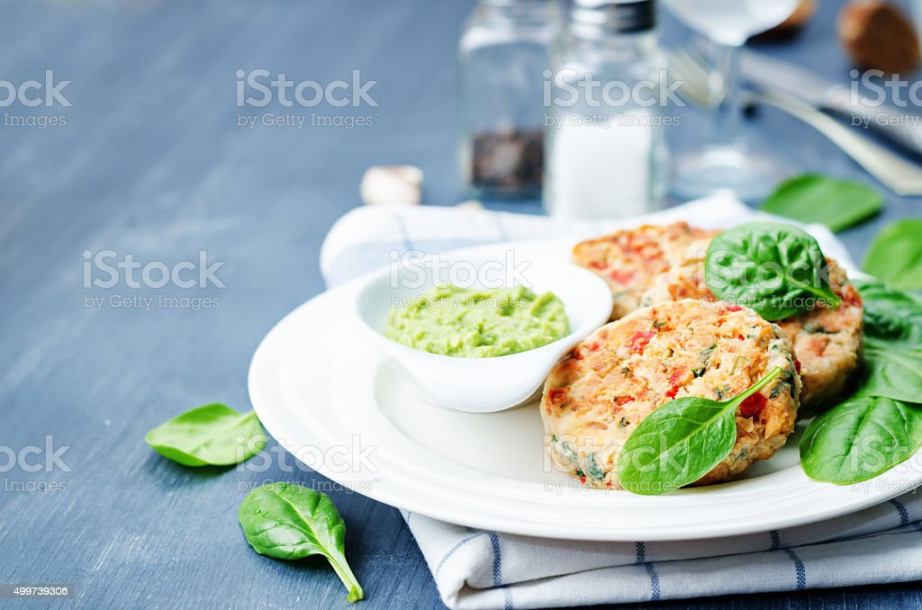vegetables spinach salmon burgers with avocado sauce stock photo