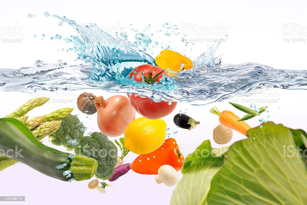 Vegetables that jump into the water stock photo