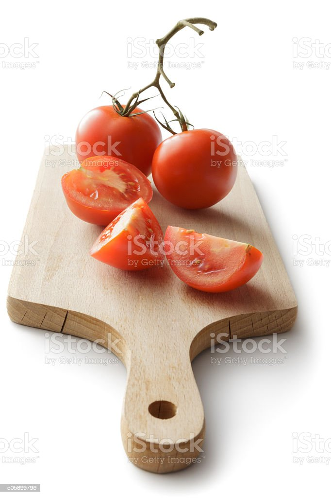 Vegetables: Tomato on Cutting Board Isolated on White Background stock photo