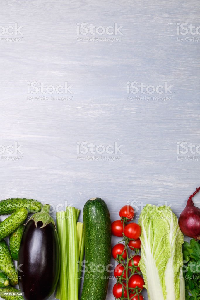 Vegetables. Tomatoes and zucchini, onion. stock photo