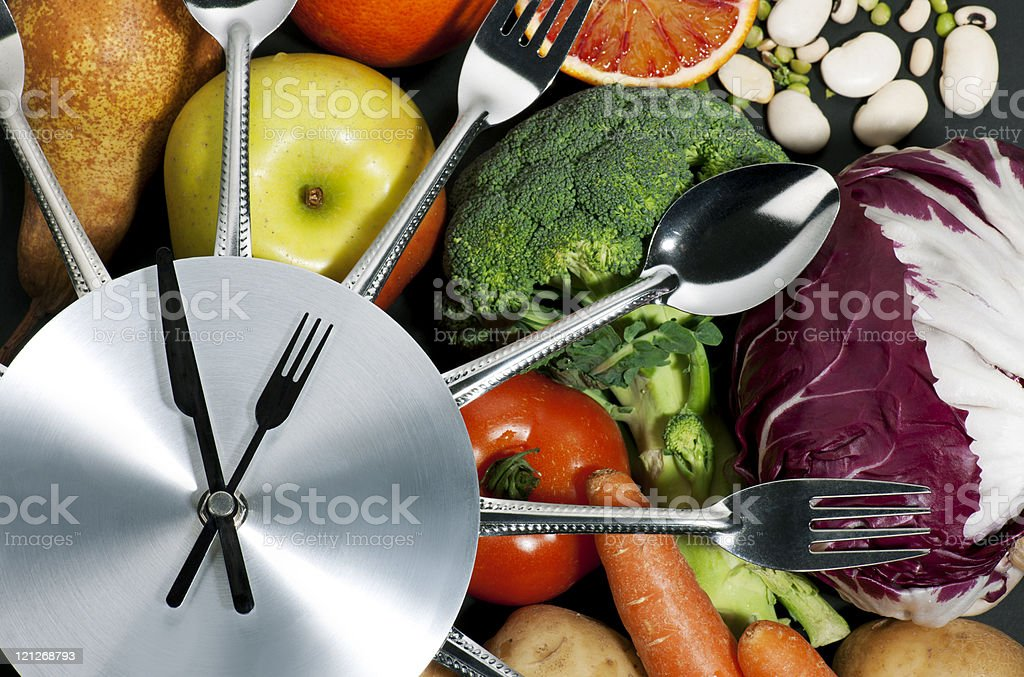 Vegetables underneath an artistic clock royalty-free stock photo