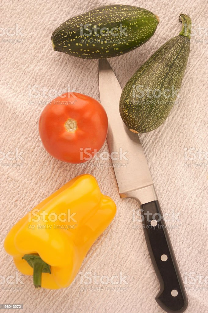 Vegetables with knife on table stock photo
