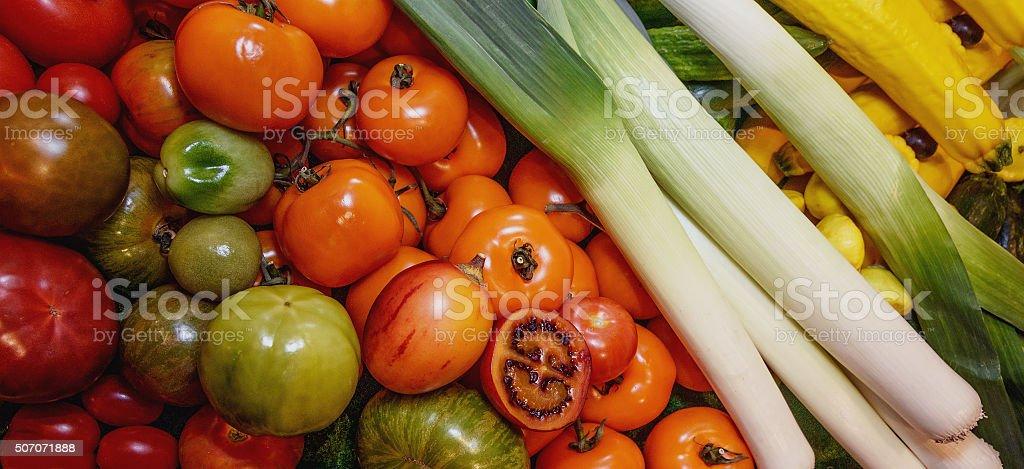 Vegetables,  yellow, green, red, black tomatoes, zucchini, leek. Vegetarianism. Close-up stock photo