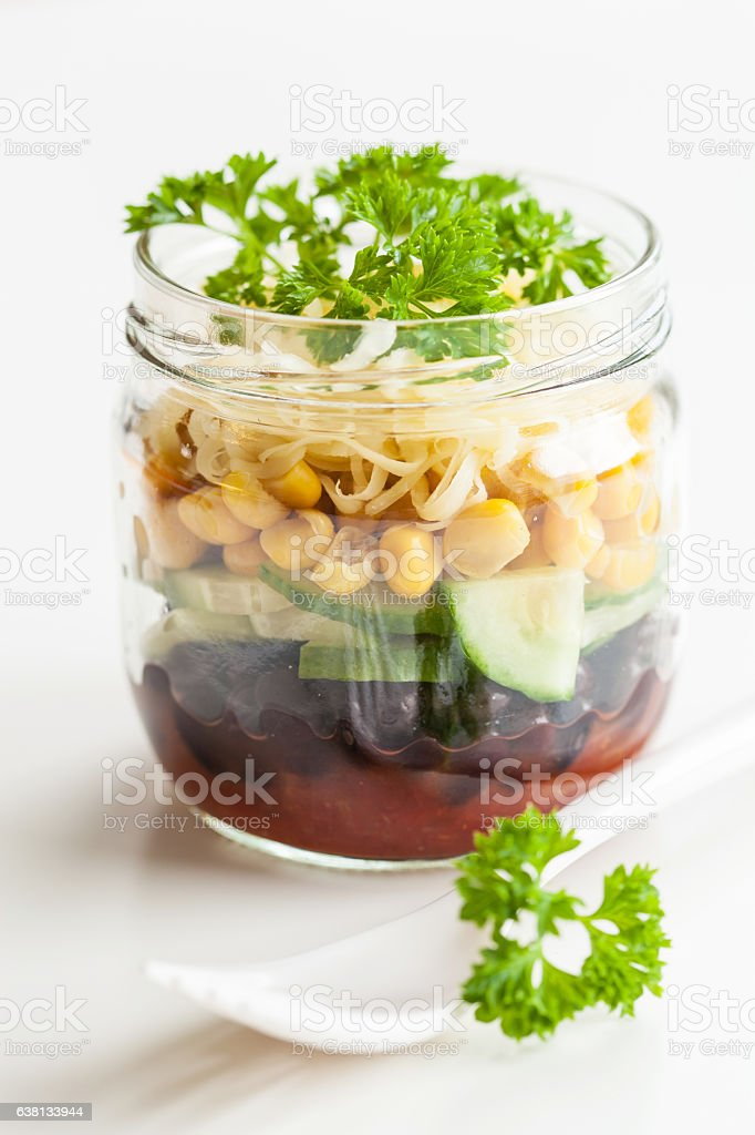 vegetarian bean sweetcorn cheese salad in mason jar stock photo