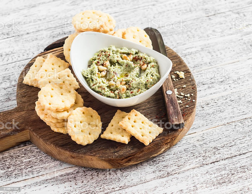 vegetarian broccoli and pine nuts hummus and homemade cheese biscuits stock photo