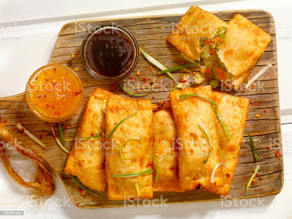 Vegetarian Eggrolls with Dipping Sauces stock photo