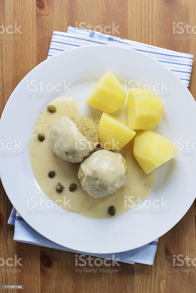 Vegetarian Fake Meatballs in a white sauce with capers royalty-free stock photo