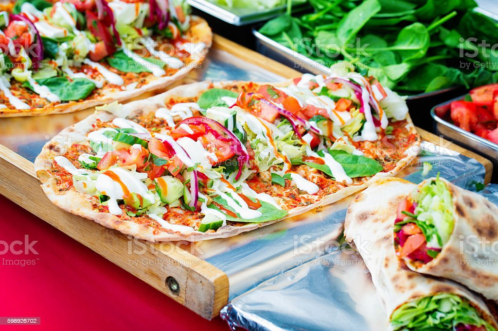 Vegetarian fantasy on flatbread at street food stall stock photo