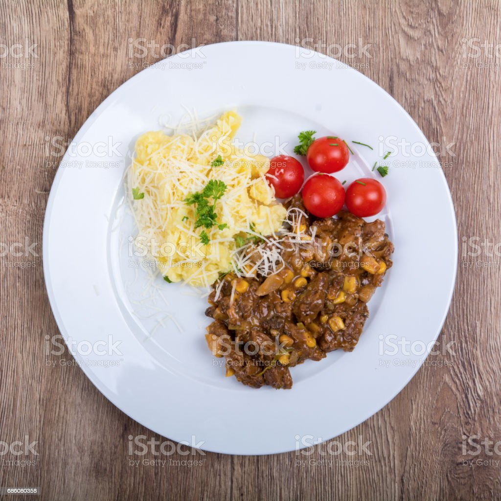 Vegetarian food on a plate with wooden background stock photo