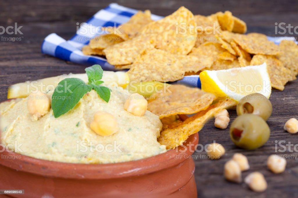 Vegetarian Humus with tortilla chips and lemon stock photo