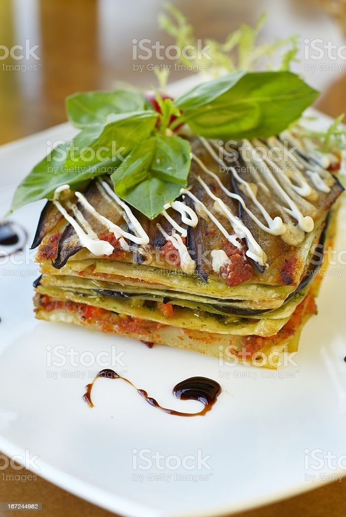 Vegetarian lasagna with vegetables, tomato and pesto sauces royalty-free stock photo