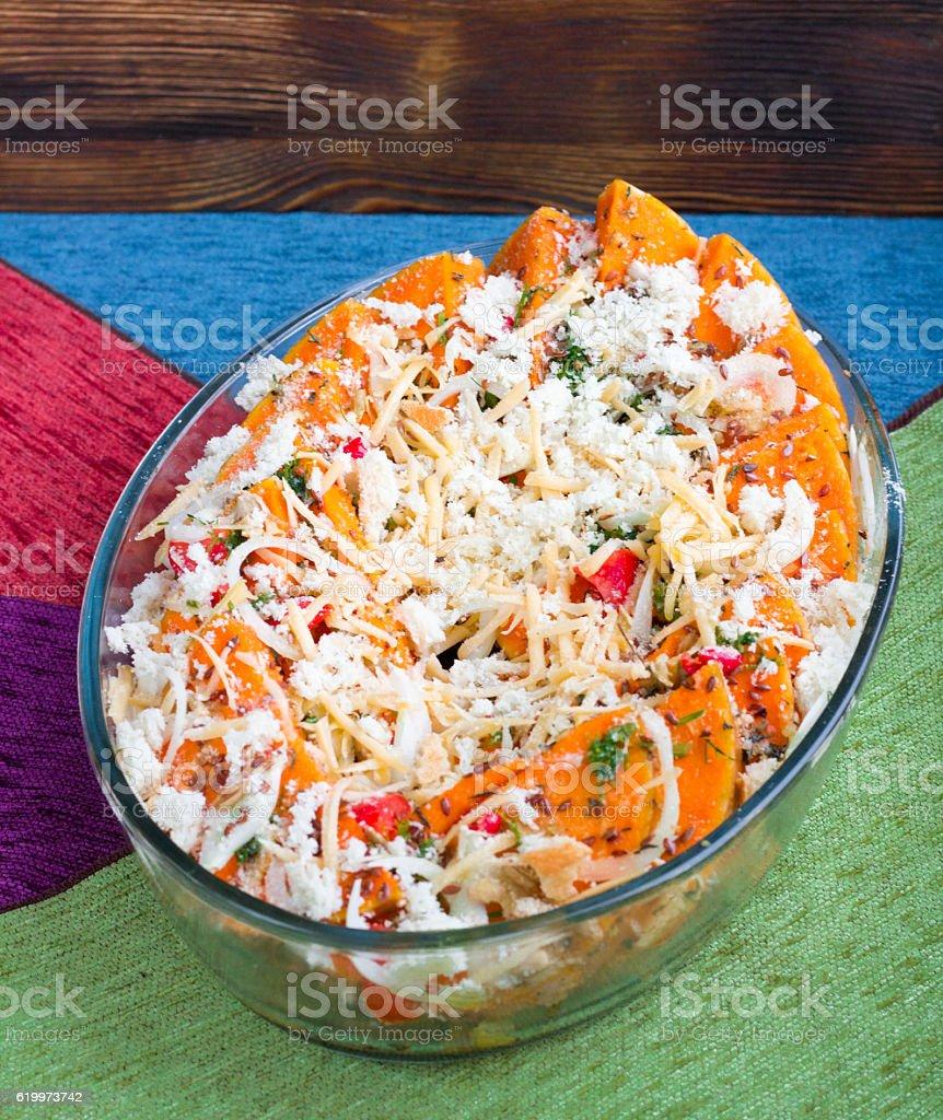 Vegetarian mixture of pumkin, vegetables, herbs and cheese stock photo