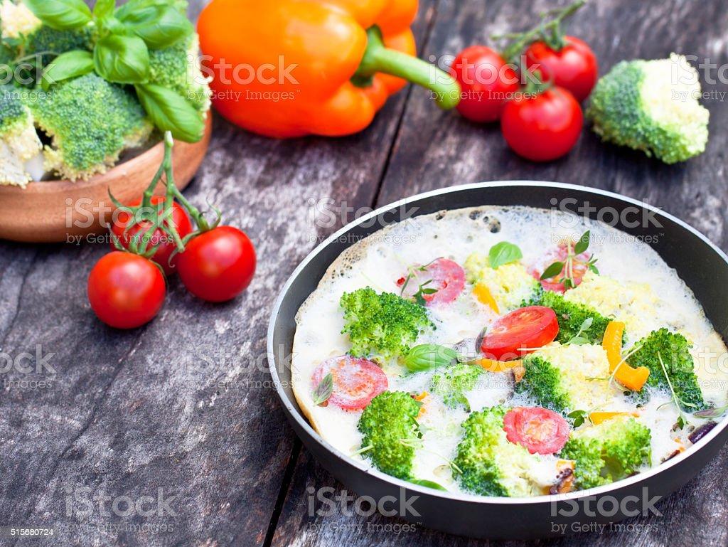 vegetarian  omelette with broccoli cherry tomato orange pepper a stock photo