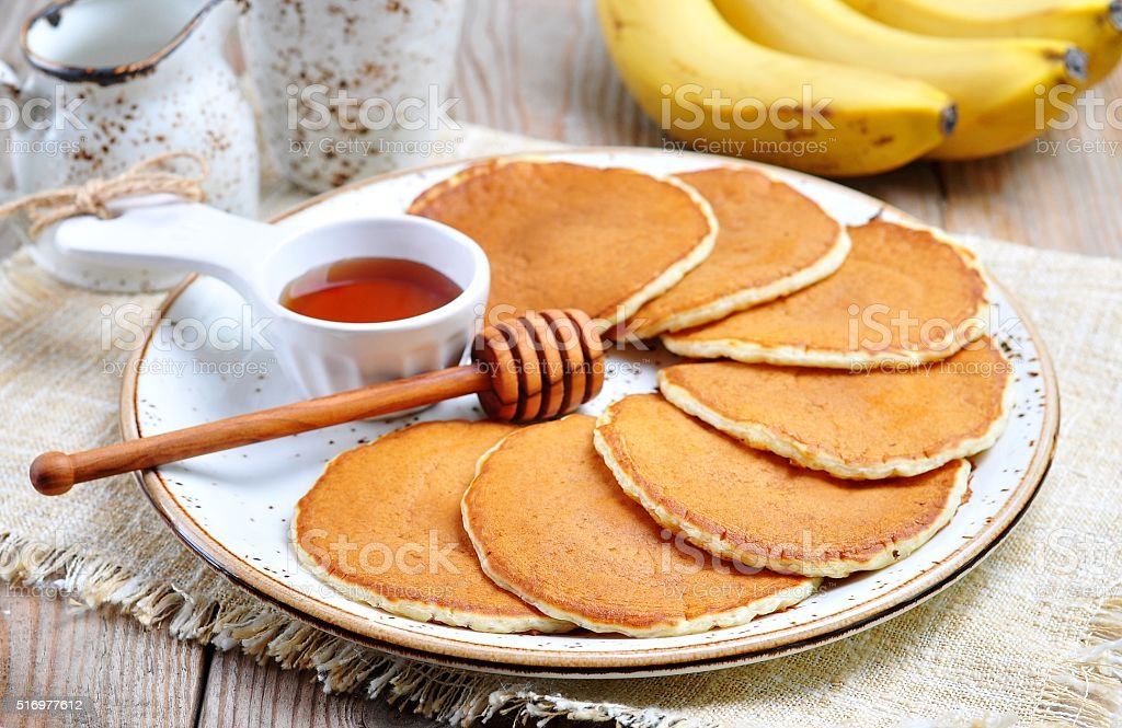 Vegetarian Pancake without eggs with organic agave syrup, bananas stock photo