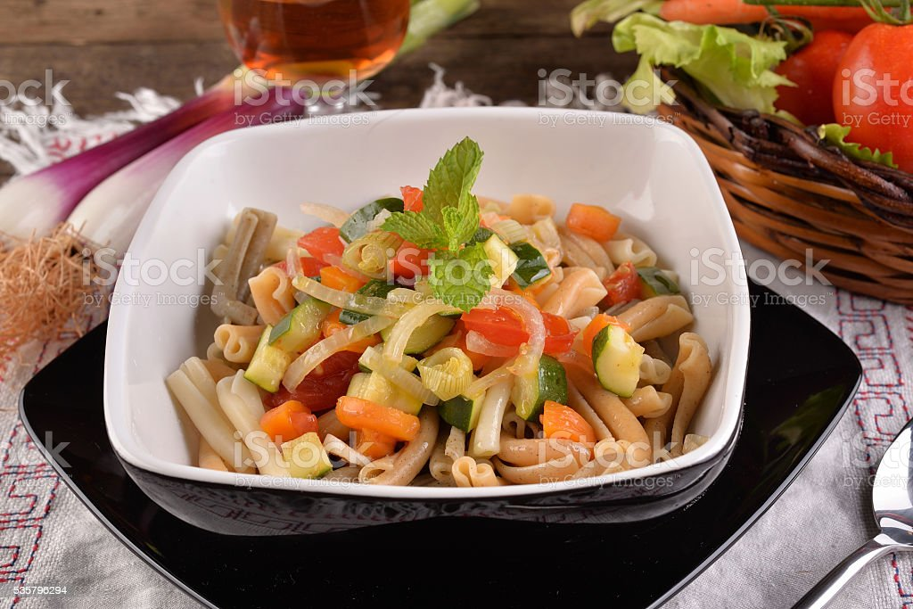 vegetarian pasta dish with fresh vegetables stock photo