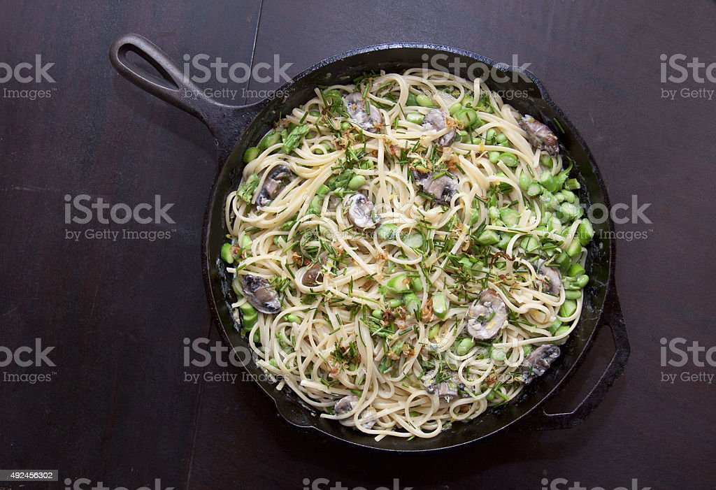 Vegetarian pasta in a cast iron skillet stock photo