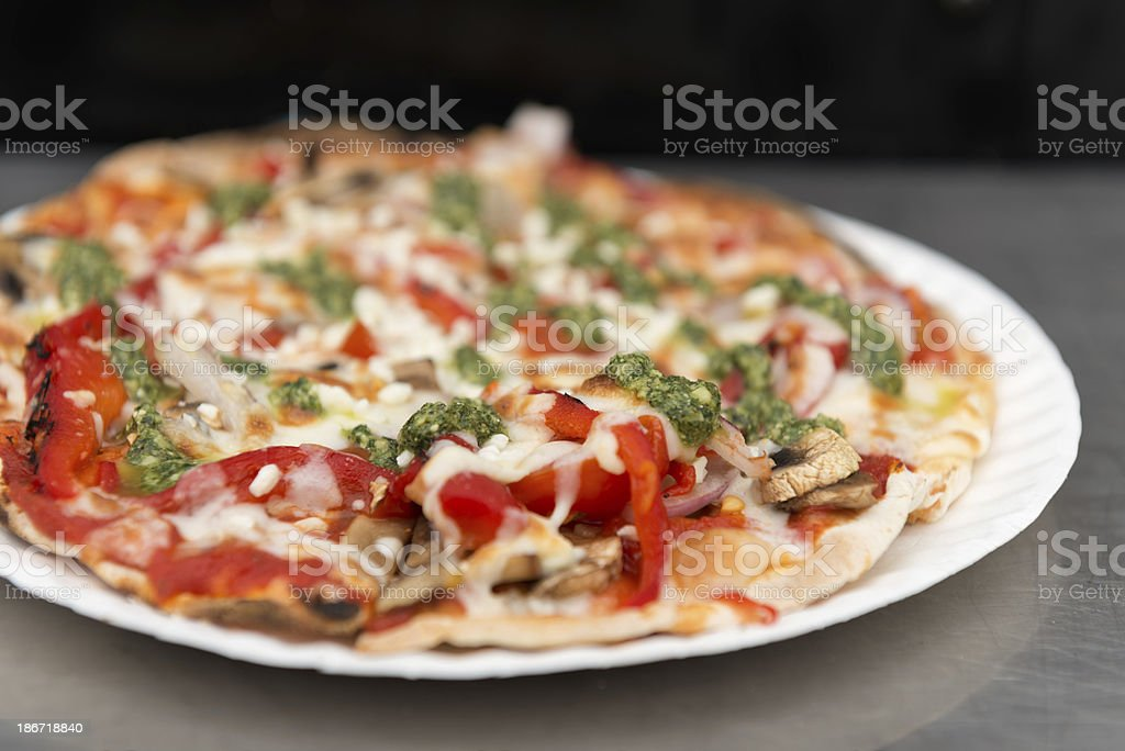 Vegetarian Pesto Pizza on a Stainless Steel Table royalty-free stock photo