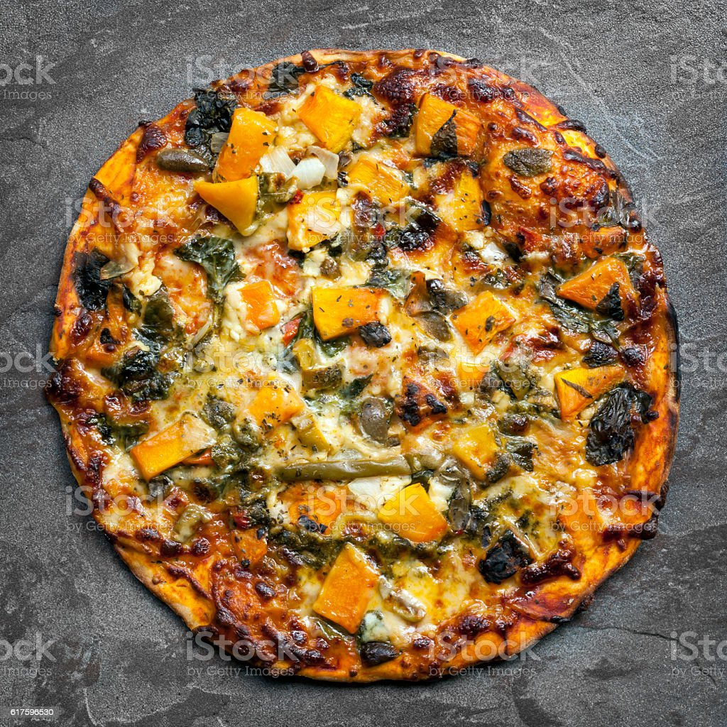 Vegetarian Pizza Top View on Slate stock photo