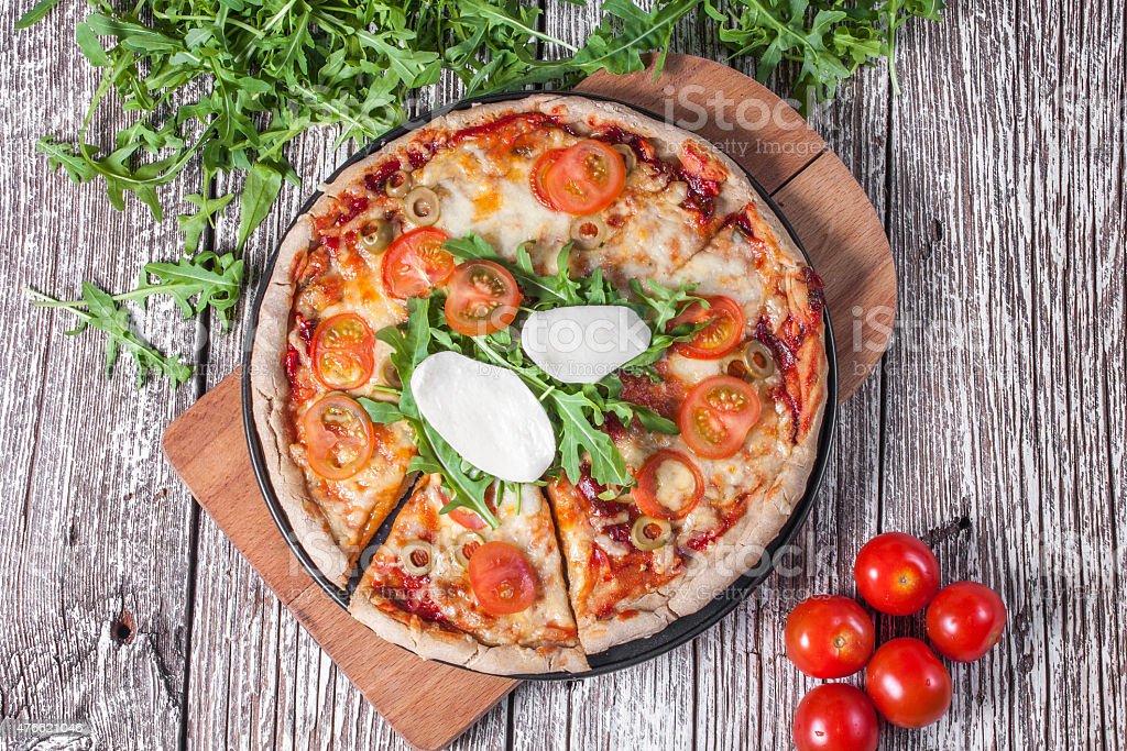 Vegetarian pizza with mozzarella and arugula. stock photo