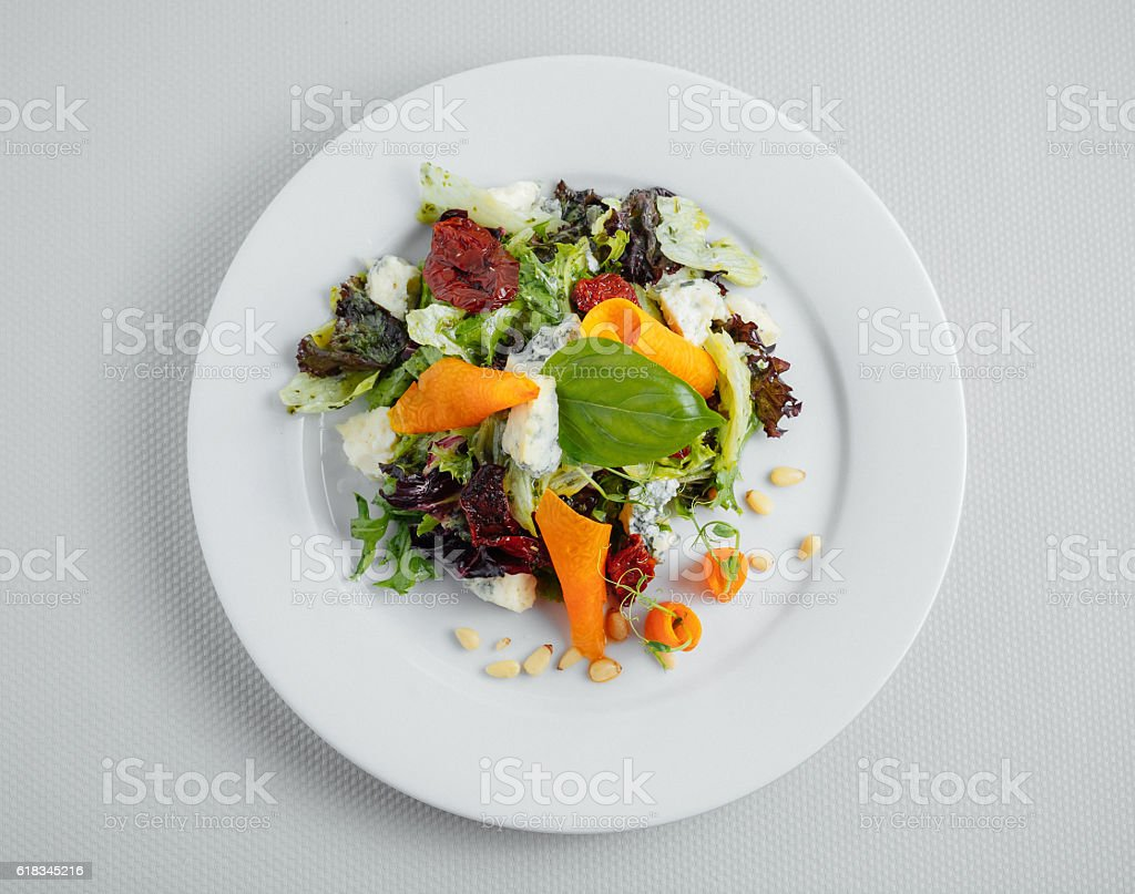 Vegetarian salad on a white plate. View from above stock photo