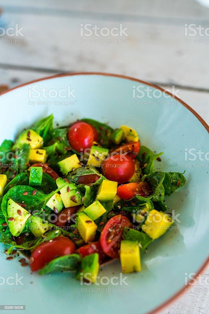 Vegetarian salad, spinach, avocado stock photo