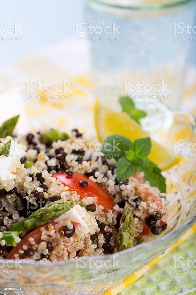 Vegetarian salad with asparagus, lentils, quinoa and tofu stock photo