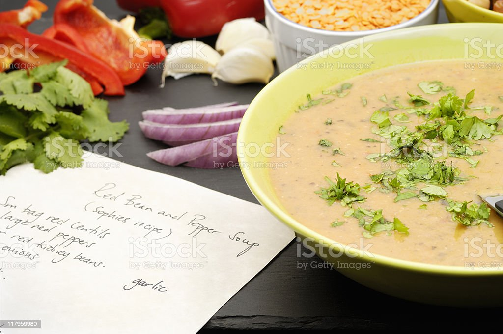 Vegetarian soup with ingredients and recipe stock photo