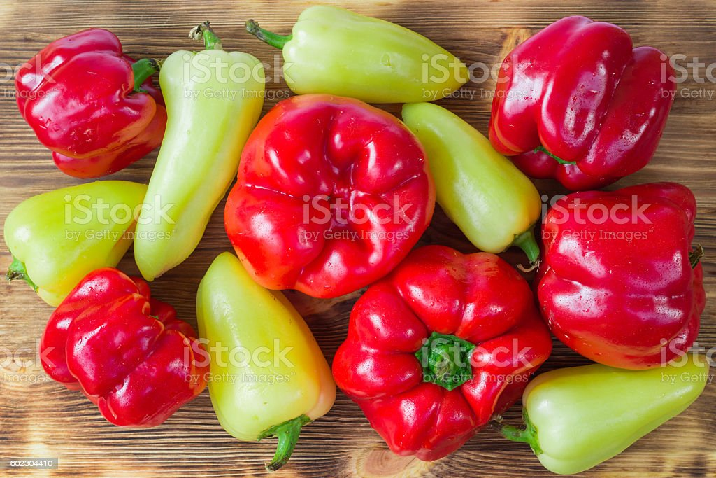 Vegetarian still life of mature red and green peppers stock photo