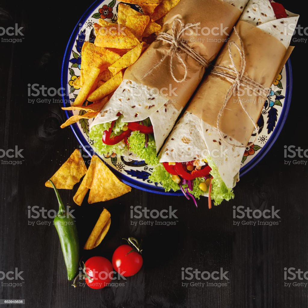 Vegetarian tartilla home with tomatoes, cabbage, cheese and sala stock photo