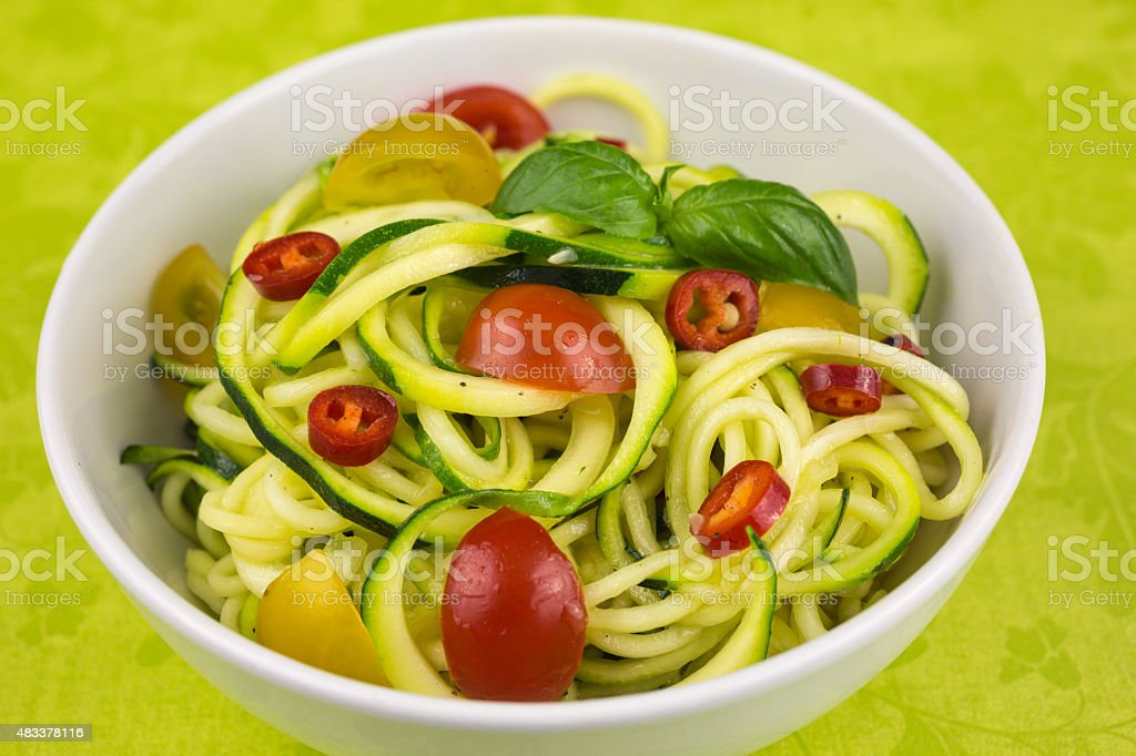 vegetarian zucchini noodles stock photo