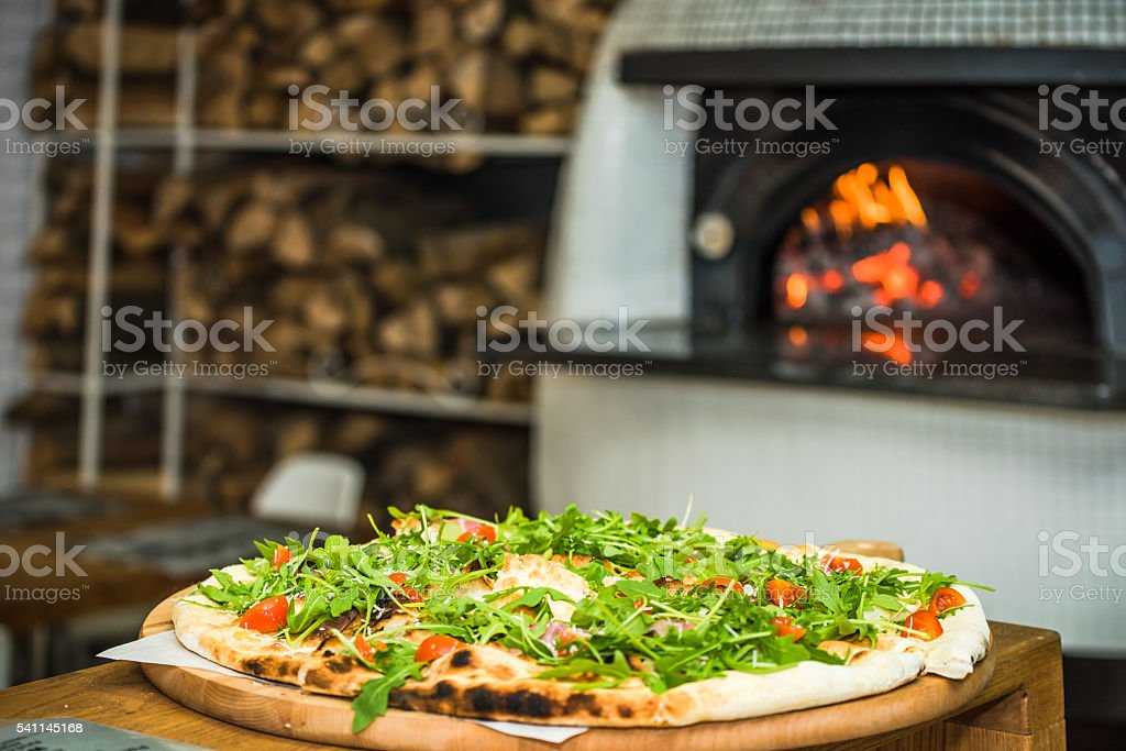 vegeterian pizza with oven in background stock photo