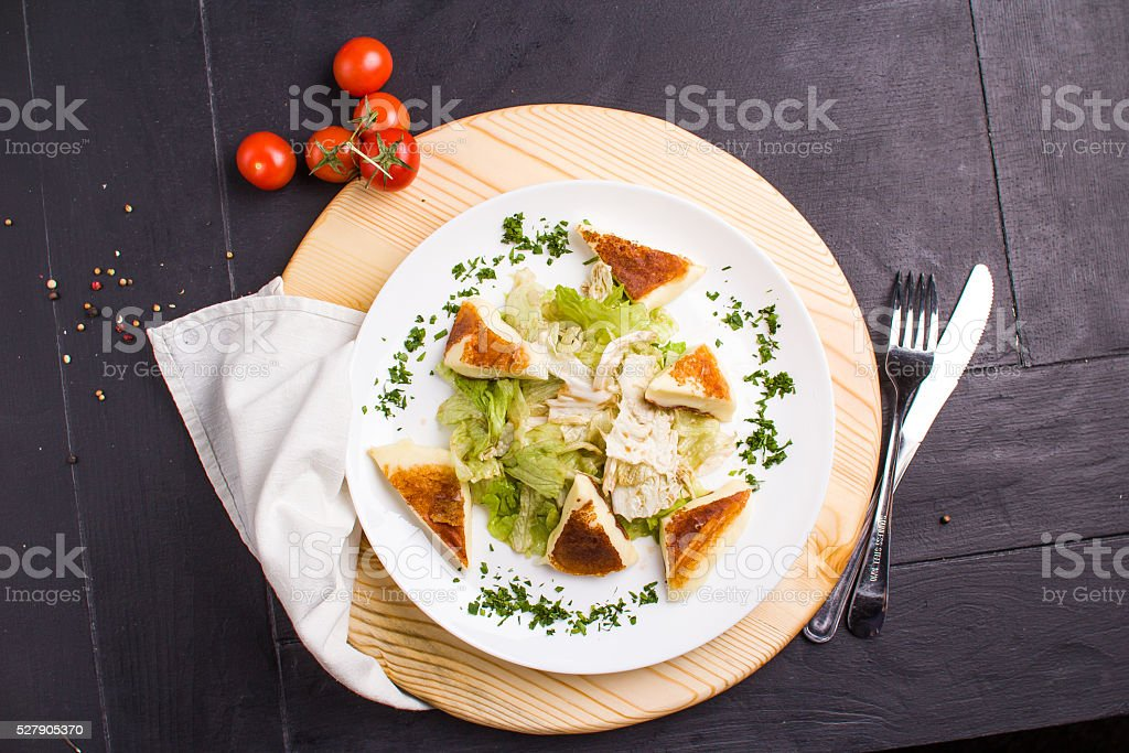 Vegeterian salad with fried cheese stock photo