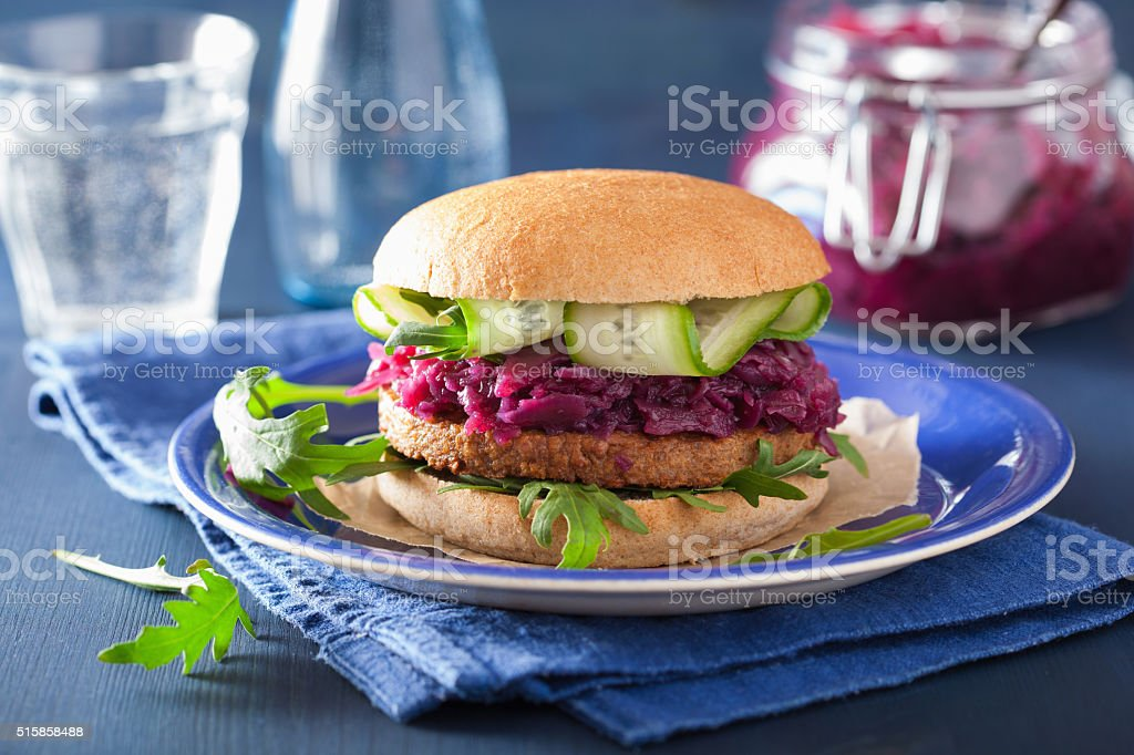 veggie soy burger with pickled red cabbage cucumber arugula stock photo