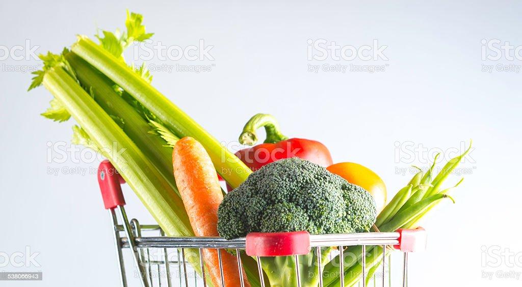 veggies in a shopping cart stock photo