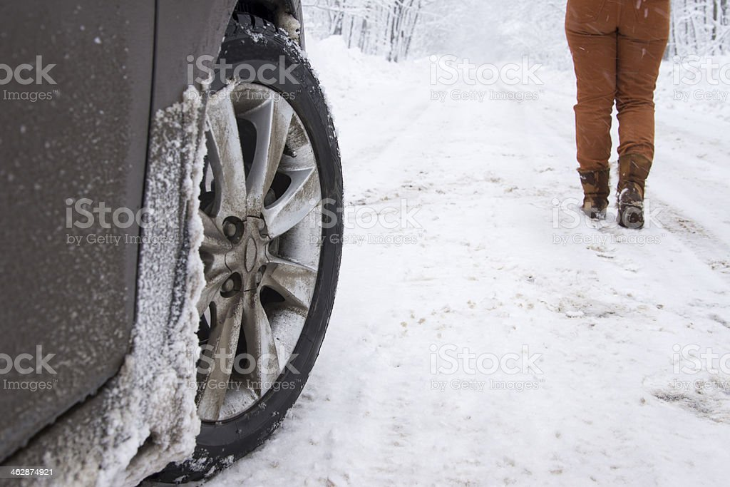 Vehicle and pedestrian on winter road stock photo