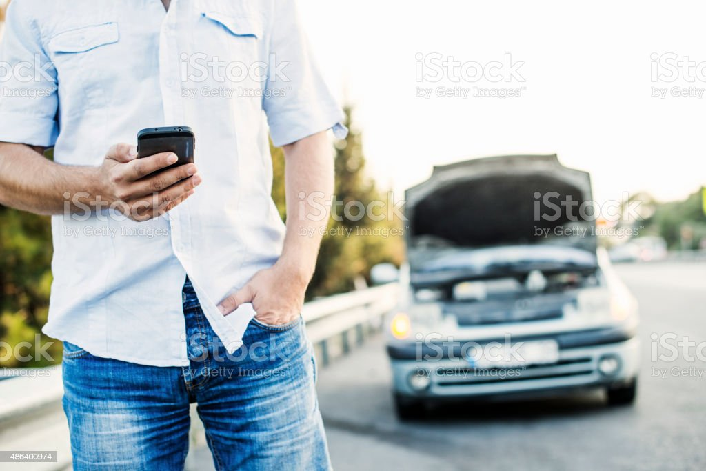 Vehicle Breakdown - Calling Roadside assistance stock photo