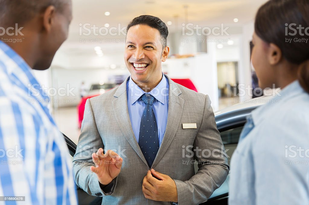 vehicle dealer talking to customers stock photo