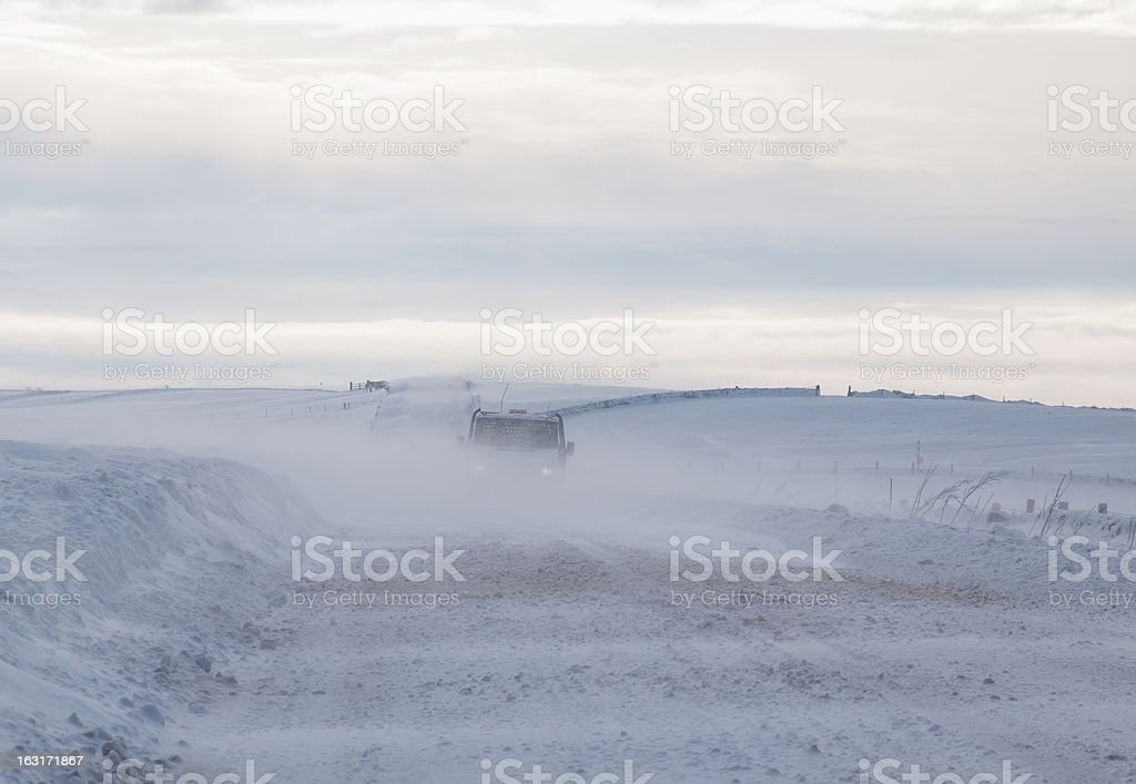 vehicle driving in blizzard royalty-free stock photo