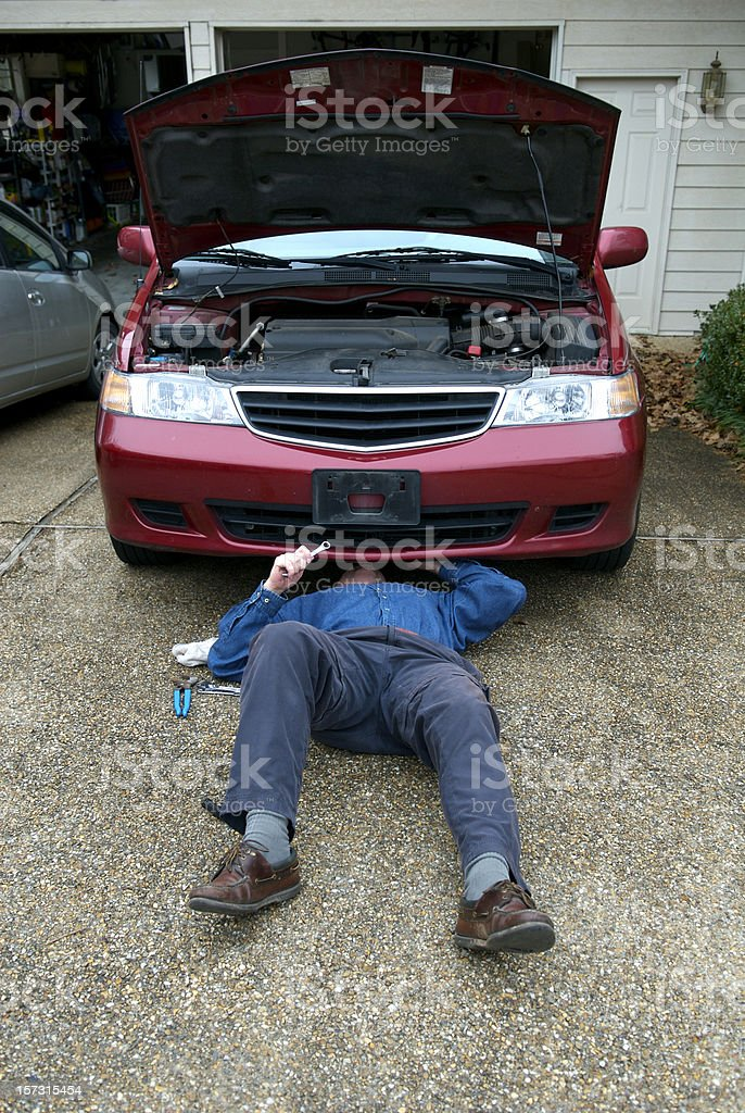 Vehicle Maintenance at Home stock photo