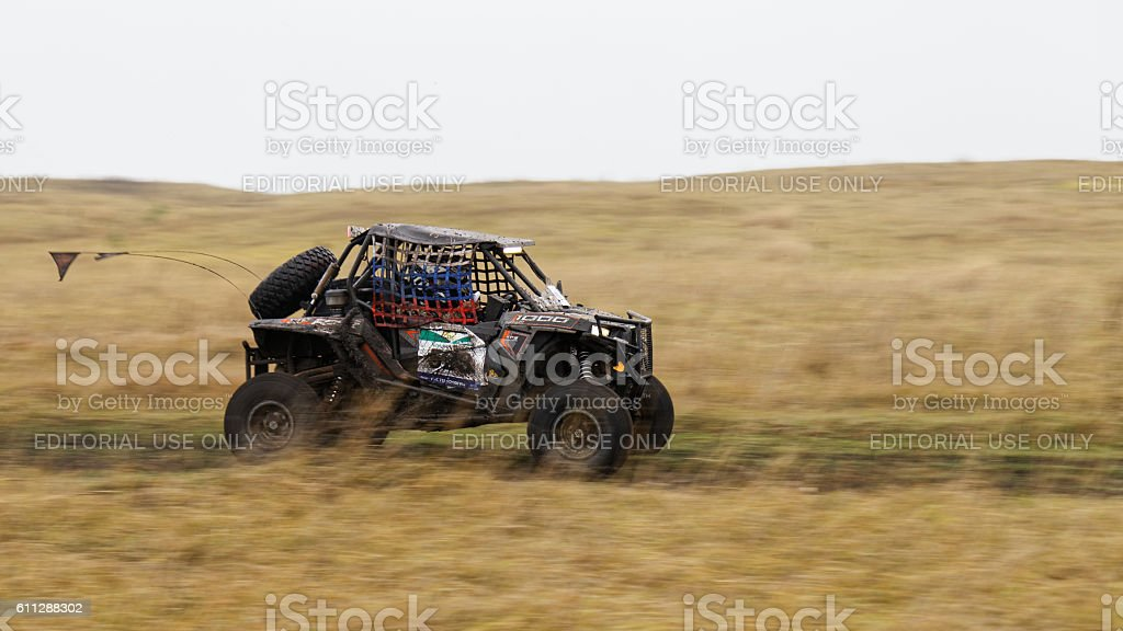 ATV vehicle on a dirt road through the fields. stock photo