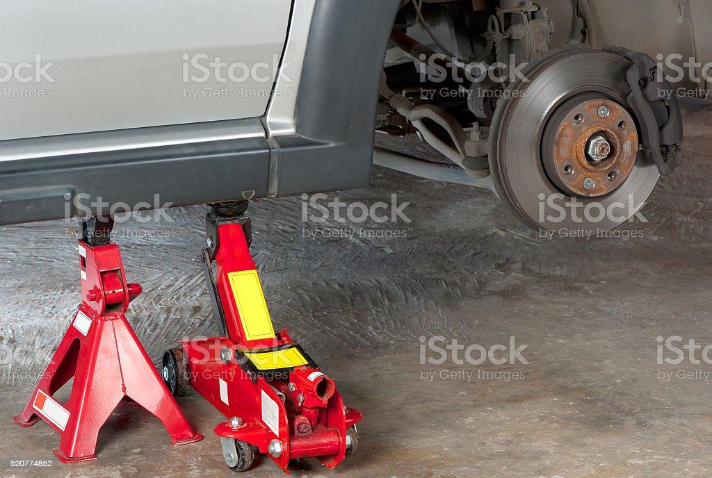 Vehicle on jack stand stock photo