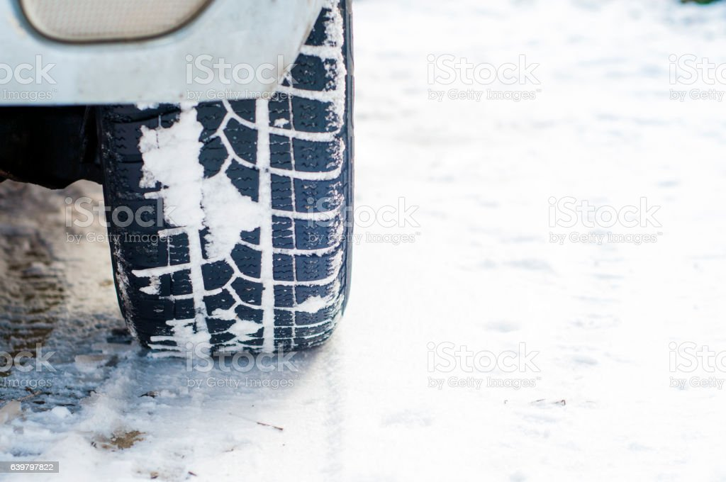 Vehicle on snowy alley in the morning at snowfall stock photo