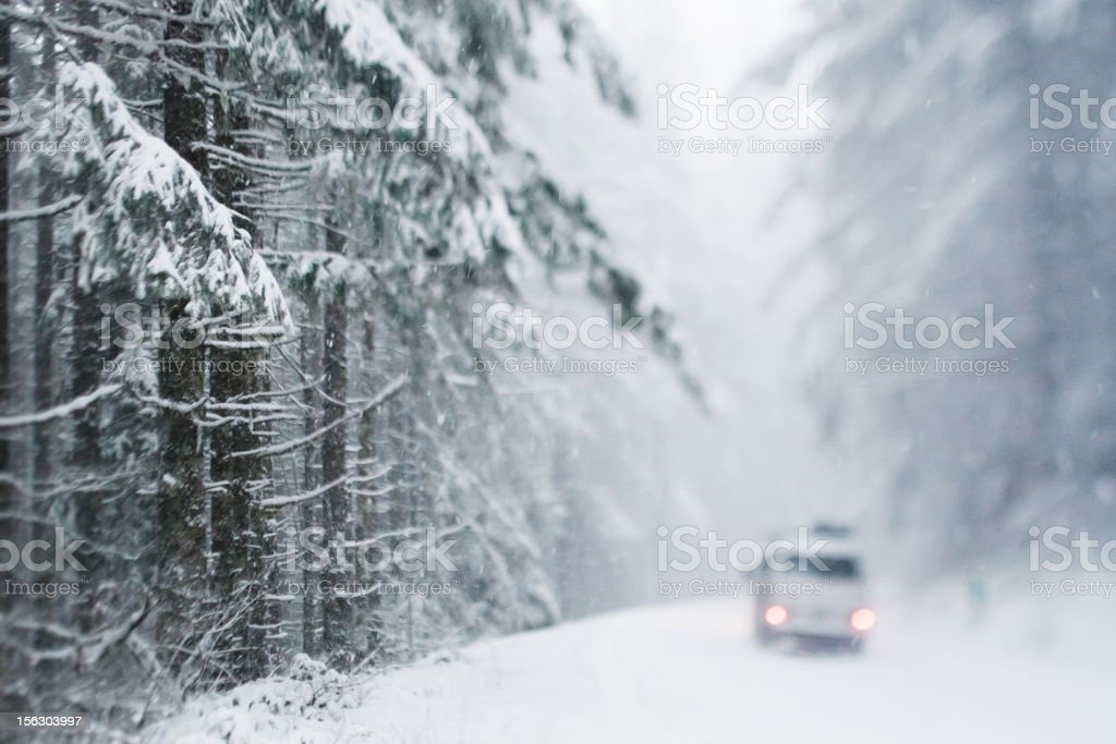 Vehicle on snowy forest road royalty-free stock photo
