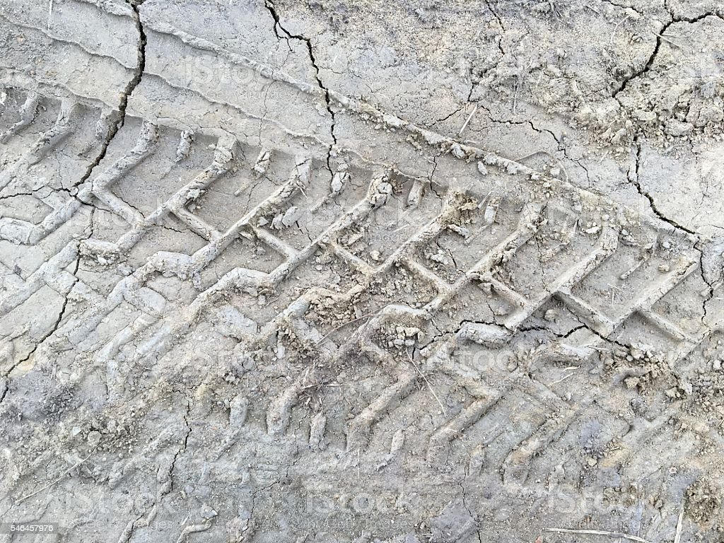 Vehicle track on dirt for background stock photo