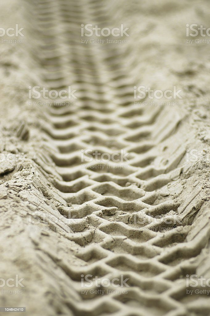 Vehicle tracks in sand royalty-free stock photo