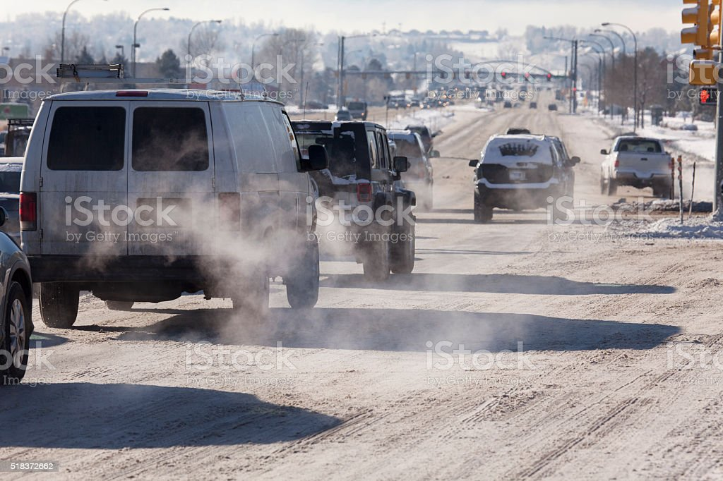 Vehicle traffic tailpipe emission pollution Littleton Colorado winter snow stock photo