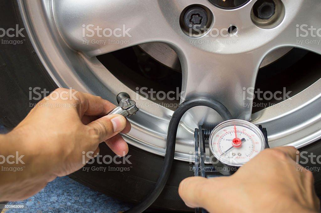 vehicle wheel add air pressure stock photo