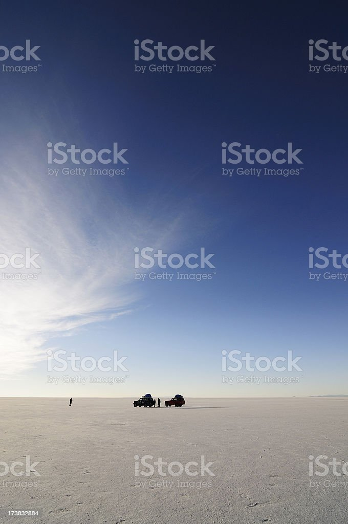 Vehicles and People on Salt Flats of Uyuni in Bolivia stock photo