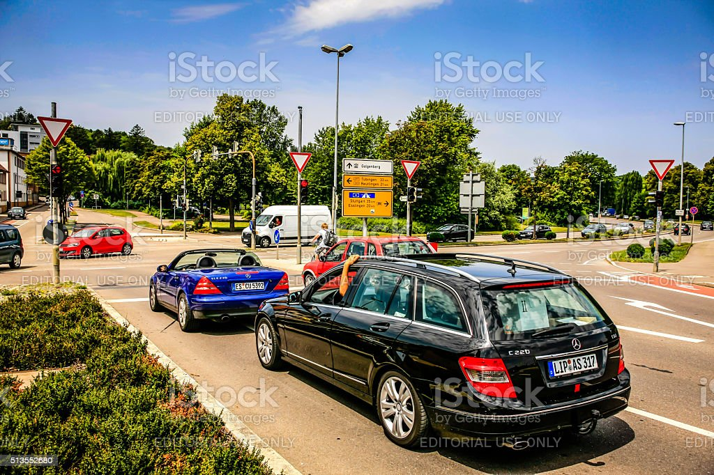 Vehicles at an intersection with traffic lights in Nurtlingen, Germany stock photo